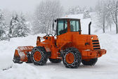 Orange snow plows to work clearing the snow from the road — Stock Photo