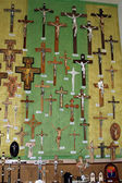 Wall full of crucifixes for sale in a shop in a shrine — Stock Photo