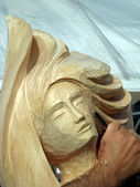 Wood craftsman who carves a face — Stok fotoğraf