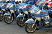 Police motorcycles lined up at a gathering of fans — Stock Photo