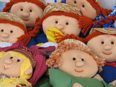 Faces of handmade rag dolls for sale at market — Стоковое фото