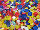 Colored plastic caps ready to be recycled — Stock Photo