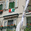 Italian flag hanging clothes drying in the Sun in Venice - Stock Photo