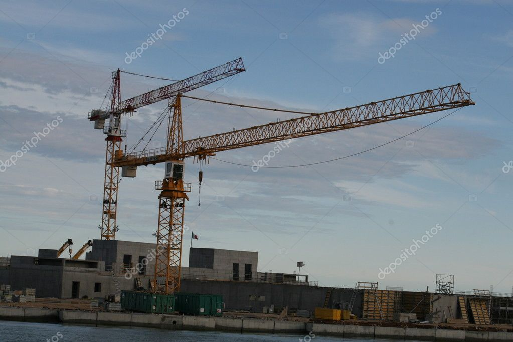 Two large cranes during the construction of a dam — Stock Photo #7186565