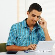 Young man using a laptop — Stockfoto