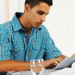 Young man using a tablet PC — Stock Photo