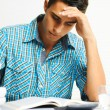 Stock Photo: Young man concentrating