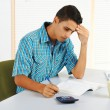 Young man trying to study — Stock Photo