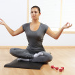 Woman doing yoga at home — Stock Photo
