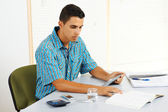 Young man studying with a tablet PC — Stockfoto