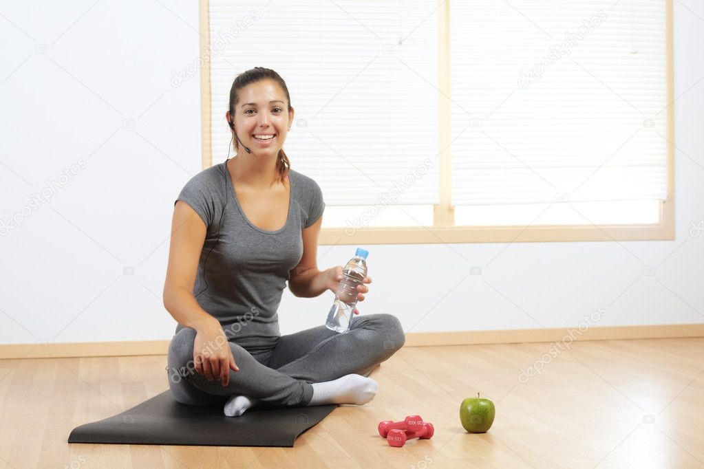 Beautiful Hispanic girl resting from sport exercises  Stock Photo #7313315