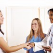 Doctor greeting a patient — Stock Photo