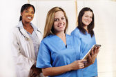 Nurse standing in front of his team — Stock Photo