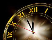 Zlaté hodiny na černém pozadí — Stock fotografie