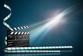 Clap board ant film strip on dark blue background — Stock Photo