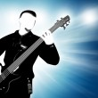 Guitarist silhouette on abstract background — Stock Photo