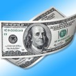 Stock Photo: One hundred dollars on blue background