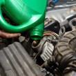 Stock Photo: Car mechanic changing oil