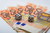 Double six dice on the 50 euro's notes — Stock Photo