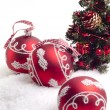 Three red balls and christmas tree — Photo