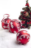 Three red balls and christmas tree — Stok fotoğraf