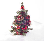 Christmas tree placed in snow — Stock Photo