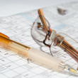 Stock Photo: Photo of crossword, glasses, pen