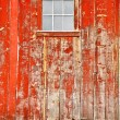 Red old barn with one window — Stock Photo
