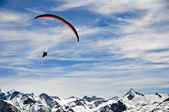 Winter mountains and paragliding — Stock Photo