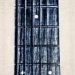 Guitar neck fingerboard on textured background — Zdjęcie stockowe