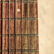 Guitar neck fingerboard on textured background — Стоковая фотография