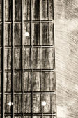 Guitar neck fingerboard on textured background — Стоковое фото