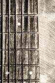 Tastiera di chitarra al collo su sfondo texture — Foto Stock