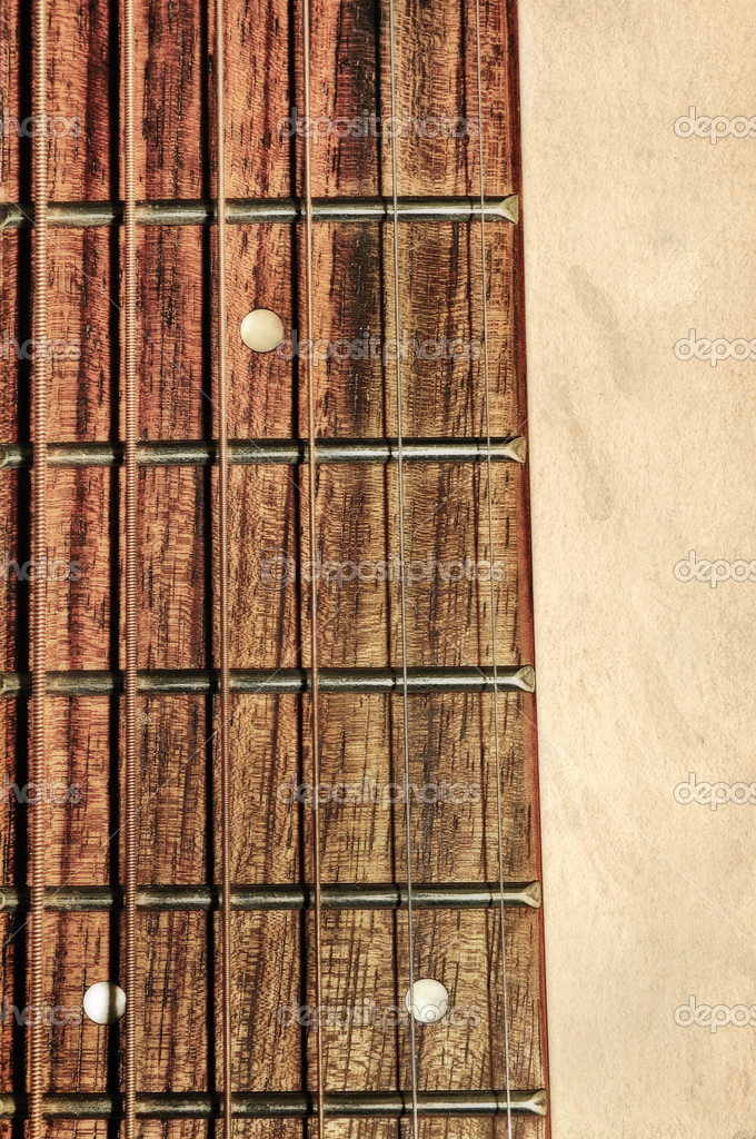 Guitar neck fingerboard on textured background — Stock Photo #7799861