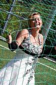 Bride in the net — Stock Photo
