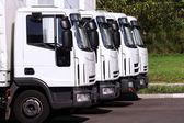Trucks in row — Stock Photo