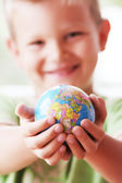 The world in kids hands — Stock Photo
