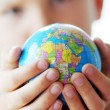Stock Photo: World in hands of our kids