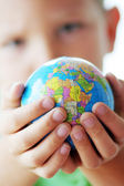 The World in the hands of our kids — Stockfoto