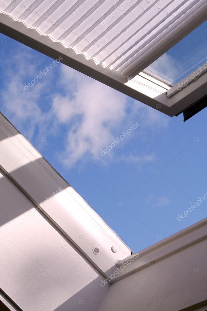 Opened roof window with shutter and clouds — Stock Photo #7126000