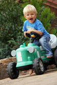 Little boy with tractor — Stock Photo