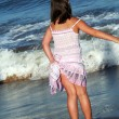 Little girl on the beach — Stock Photo #7194016