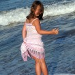 Little girl on the beach — Stock Photo #7194019