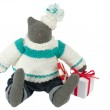 Stuffed cat toy in pants with a gift box alongside — Stock Photo #7578162