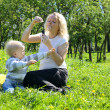 Mother and child playing on green field — Stock Photo #7168385