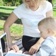 Mother and child with laptop — Stock Photo #7168404