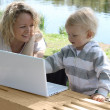 Mother and child with laptop — Stock Photo #7168419