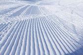 Snowcat trace on snow — Stock Photo