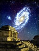 Ufo alien maya temple and galaxy — Stock Photo