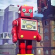 Giant tin toy robot and city — Stock Photo #7243919
